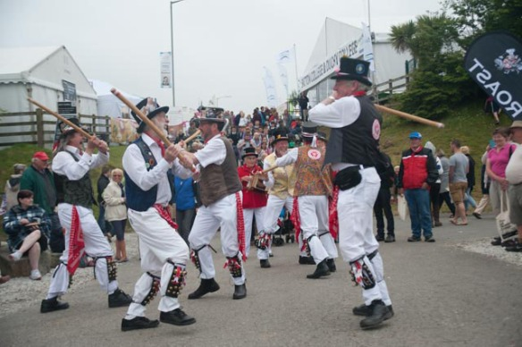 Semi-relevant photo: What's more English than morris dancing? I like this shot because the guy on the right looks like he's about to brain the guy on the left. Photo by Ida Swearingen.