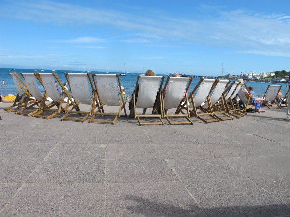 Chairs for rent, facing the beach. Swanage.