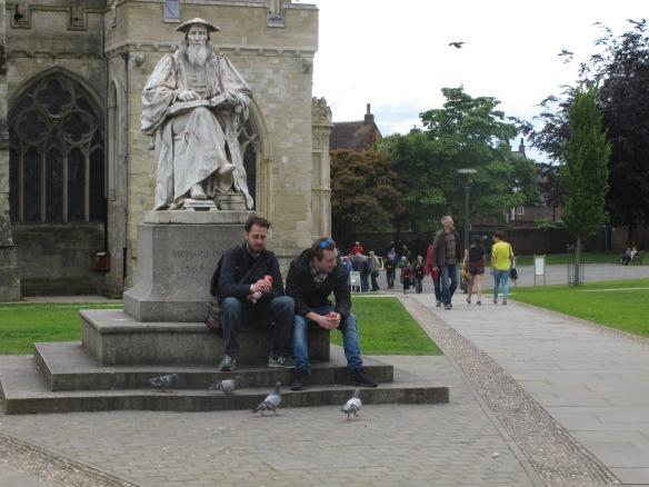 A rare relevant photo: people sitting outside Exeter Cathedral, in front of a statue of someone whose first name is Richard.