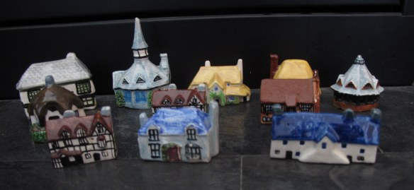 Screamingly irrelevant photo: A couple of people asked what the china cottages I wrote about looked like, and what I did with the ones I didn't send to my friend. Here are the ones I have left.