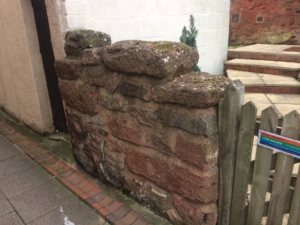 A rare relevant photo: A bit of Roman wall, now fencing off someone's garden in Exeter.